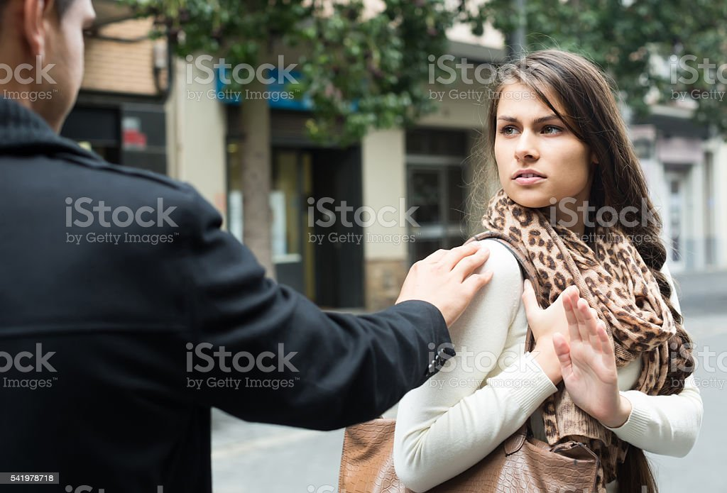 couple having argue on city street in autumn day stock photo