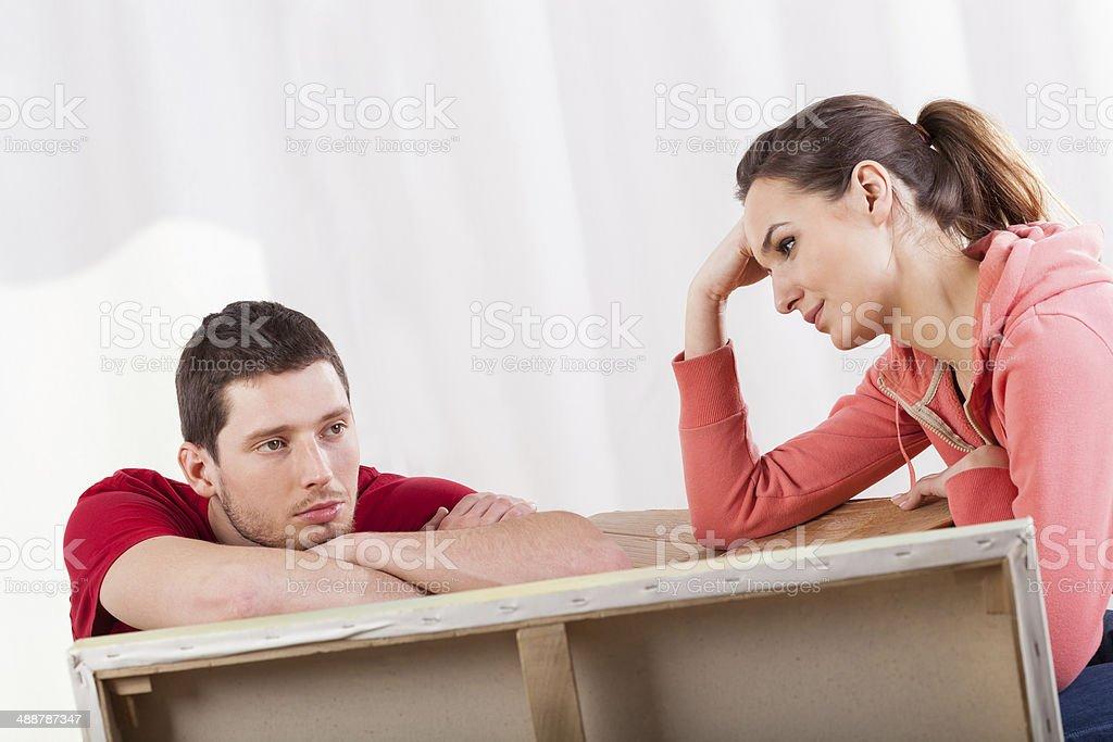 Couple having break in removal stock photo