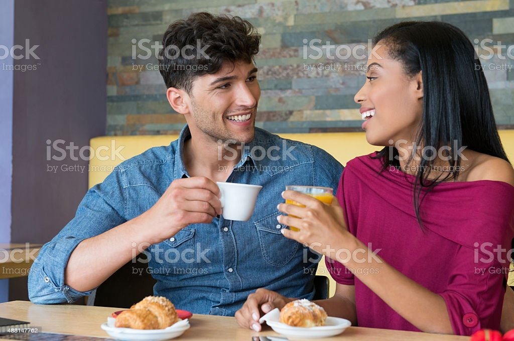 Couple having breakfast at coffee bar stock photo