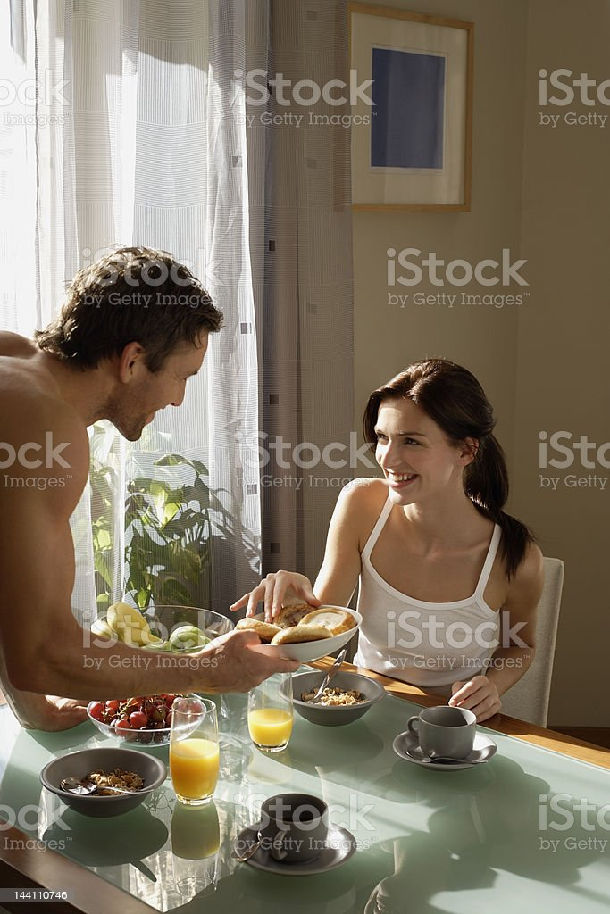 Couple having breakfast at home royalty-free stock photo