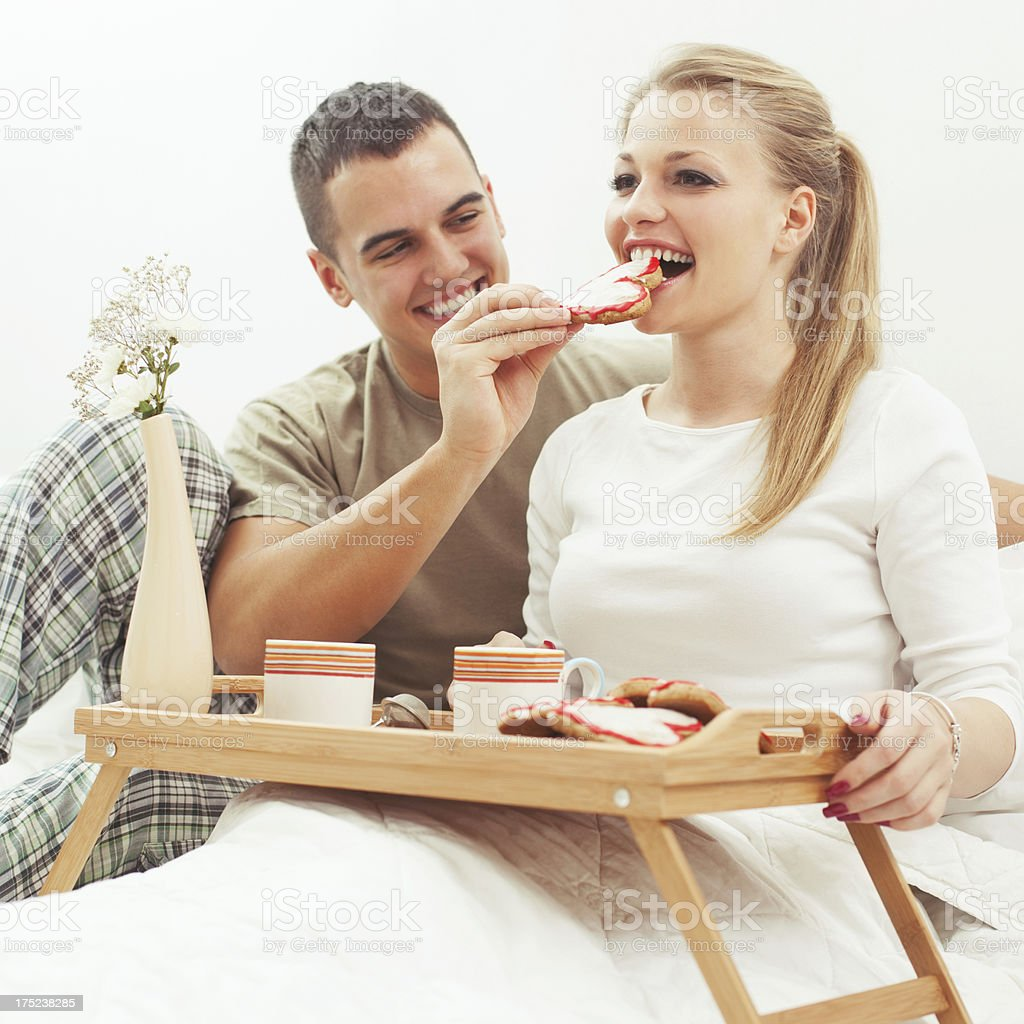 Couple having breakfast in bed royalty-free stock photo