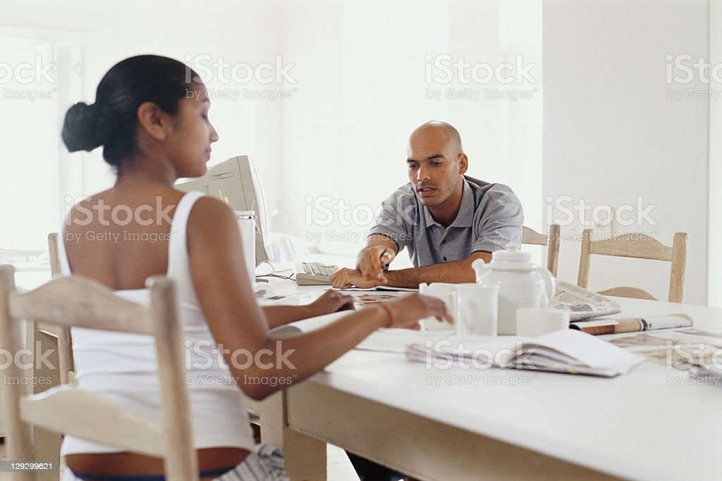 Couple having breakfast in kitchen royalty-free stock photo