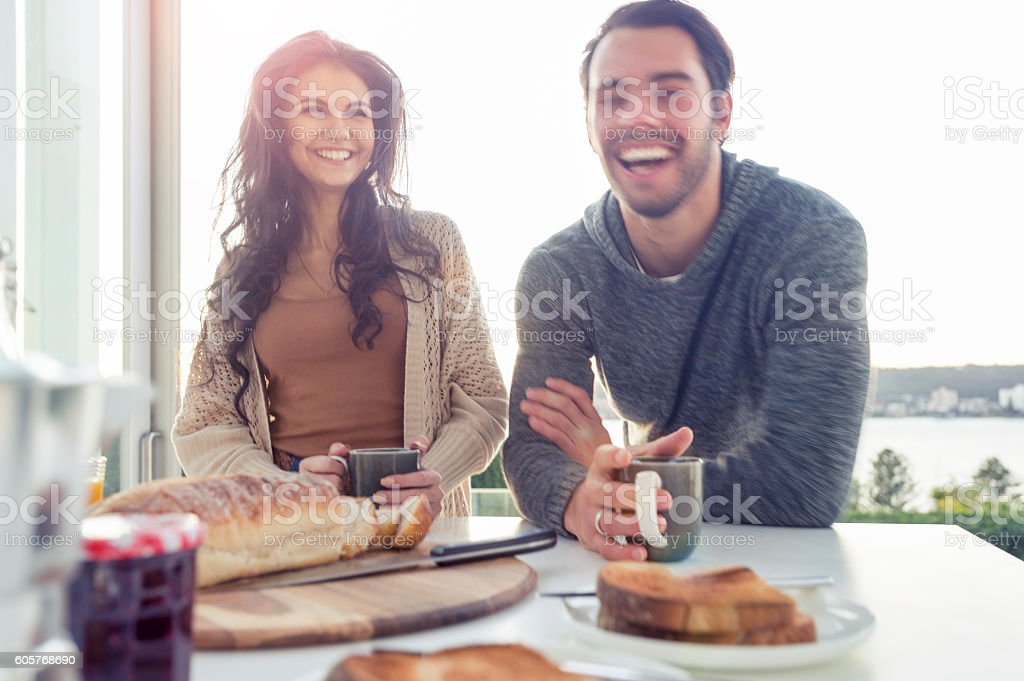 Couple having breakfast. stock photo