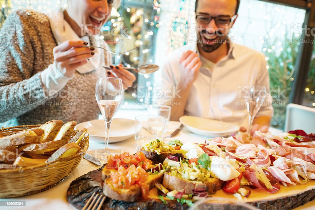 Couple having Christmas dinner in a restaurant stock photo