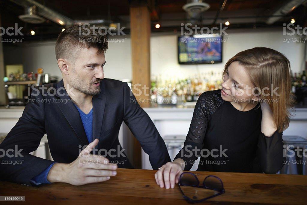Couple having conversation in a restaurant stock photo