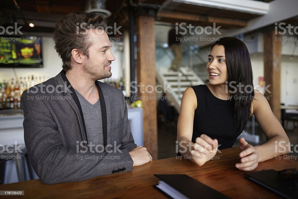 Couple having conversation in a restaurant royalty-free stock photo