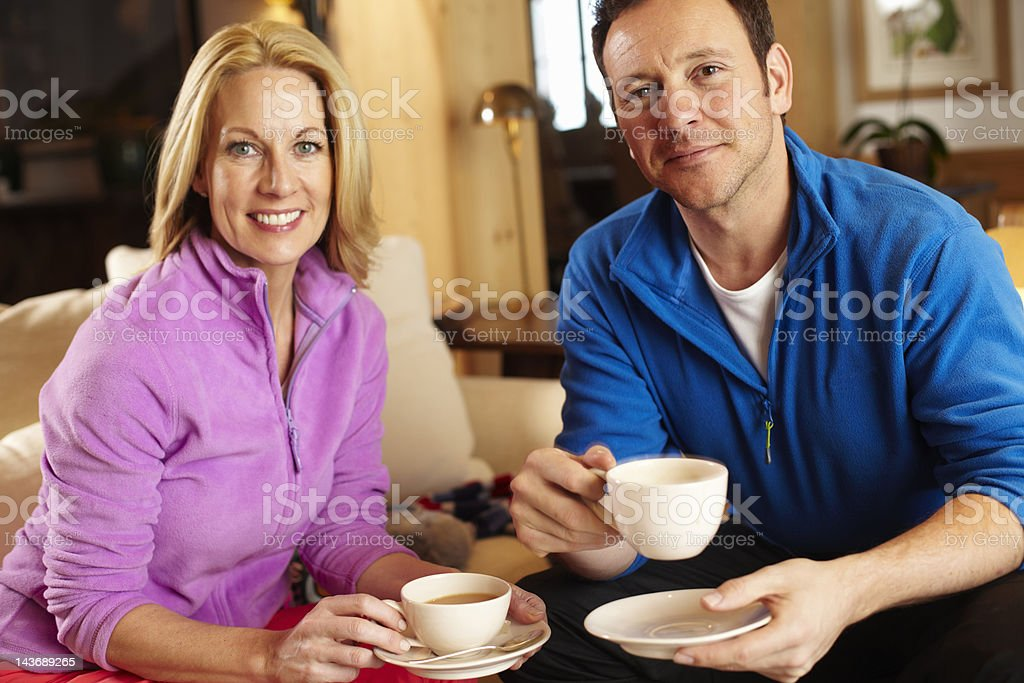 Couple having cup of coffee together royalty-free stock photo