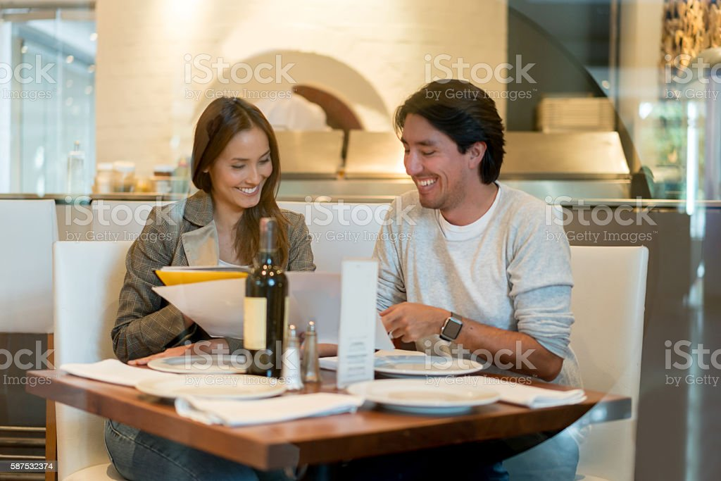 Couple having dinner at a restaurant stock photo