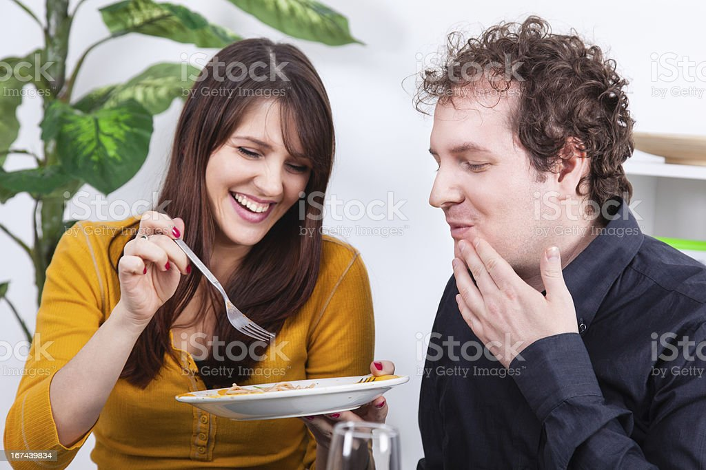 Couple having dinner at home royalty-free stock photo
