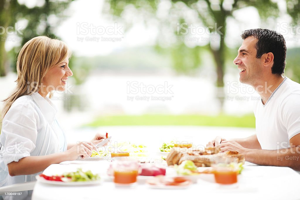 Couple having dinner outdoors. royalty-free stock photo