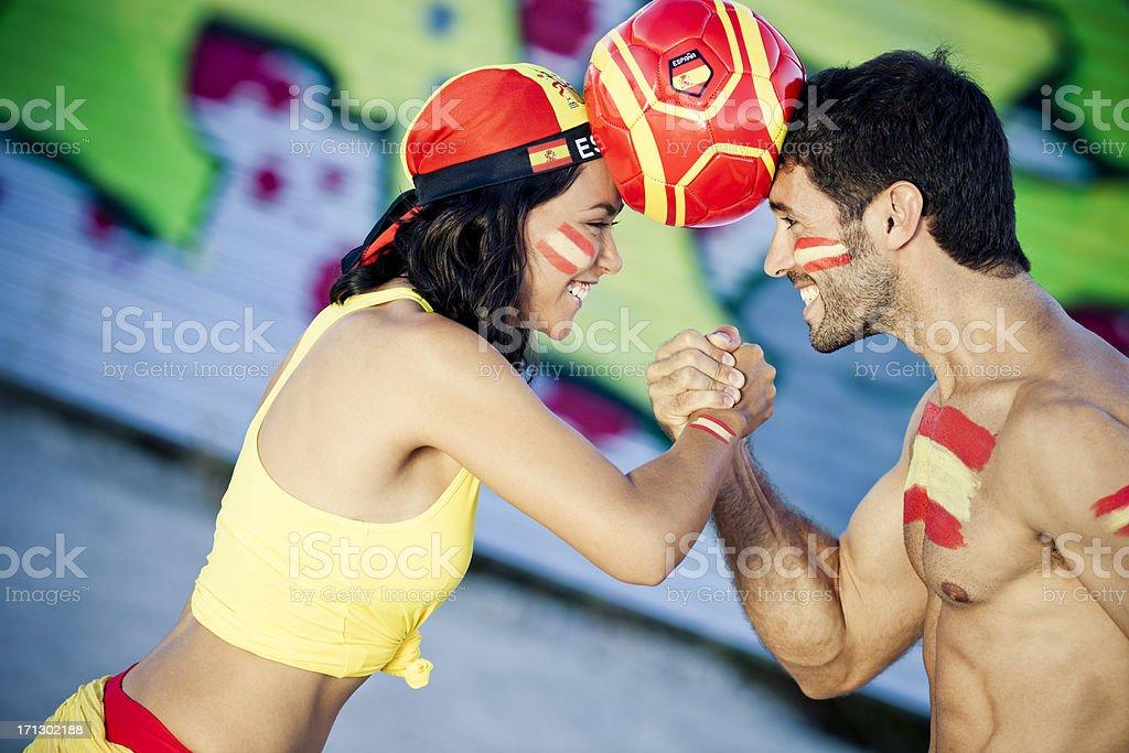 couple having fun as spanish football fans stock photo