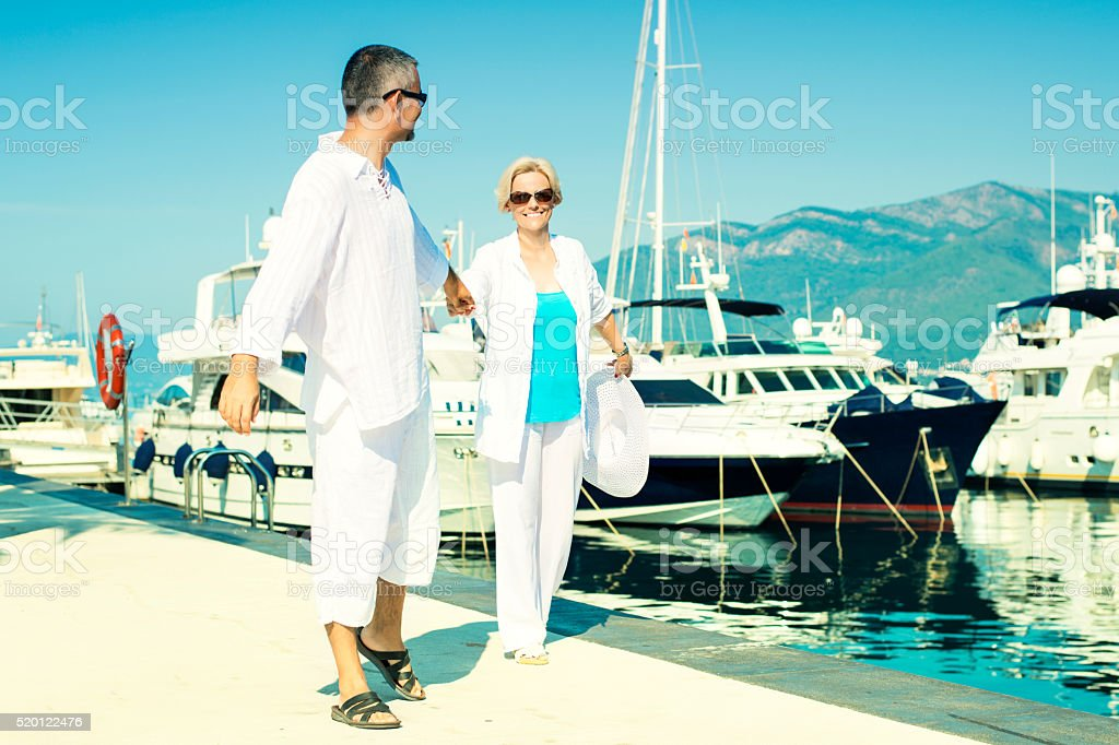 Couple having fun at Boat Dock stock photo