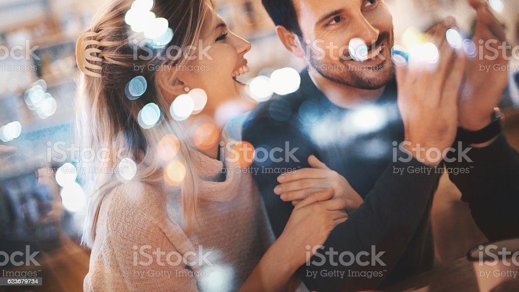 Couple having fun at coffee house. stock photo