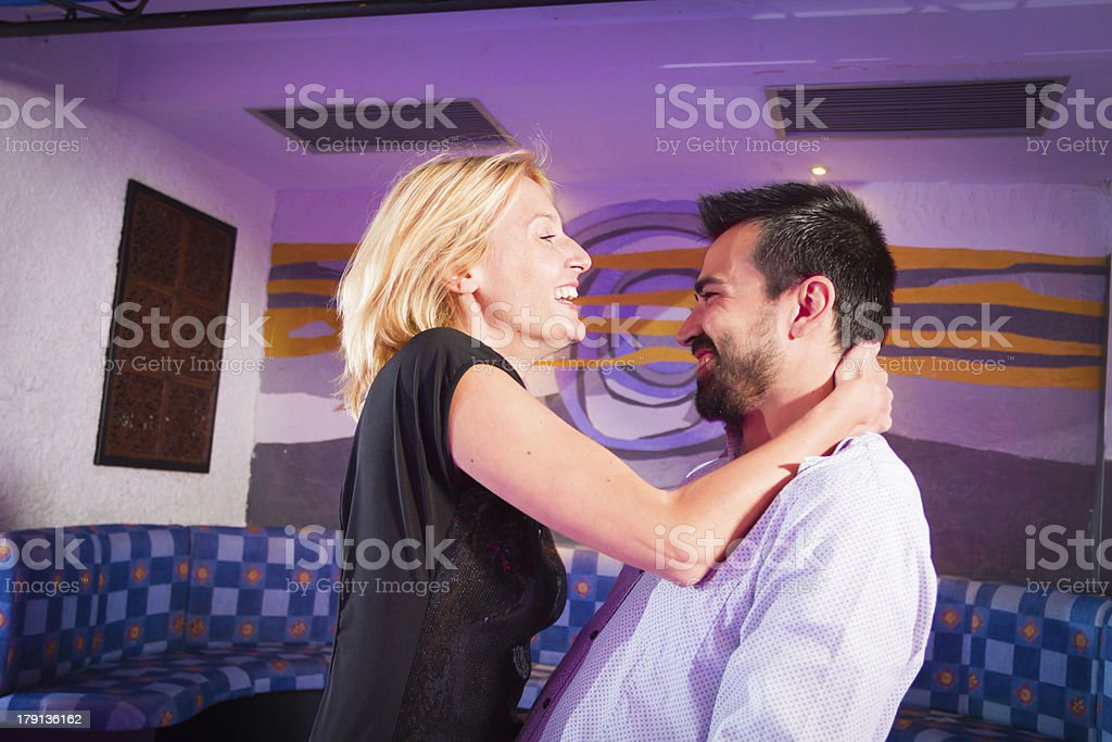 Couple having fun at Disco royalty-free stock photo