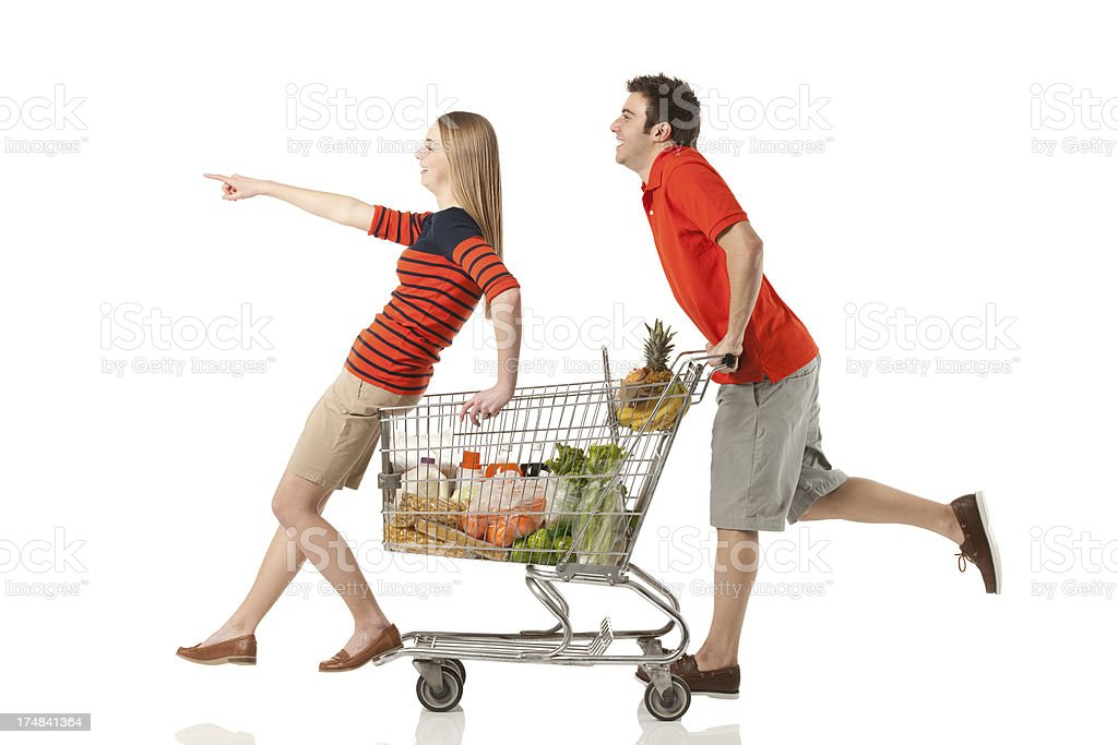 Couple having fun in a supermarket royalty-free stock photo
