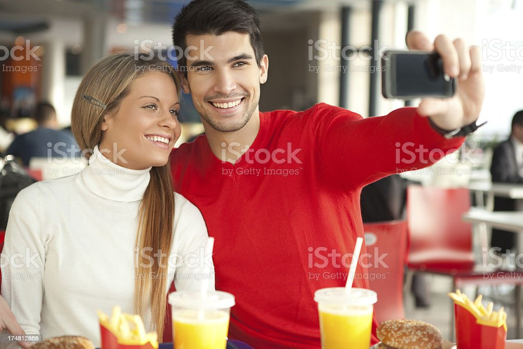Couple having fun in fast food restaurant. royalty-free stock photo
