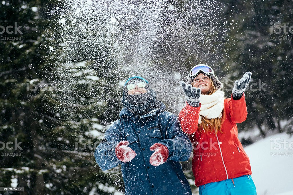 Couple having fun in forest stock photo