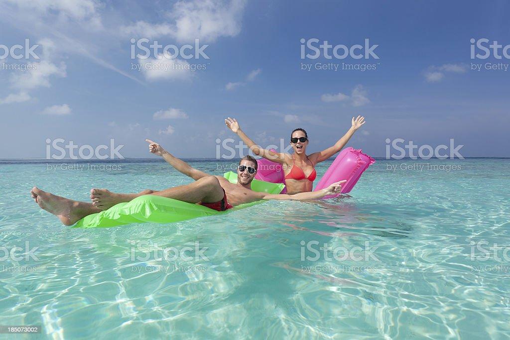 couple having fun in lagoon royalty-free stock photo