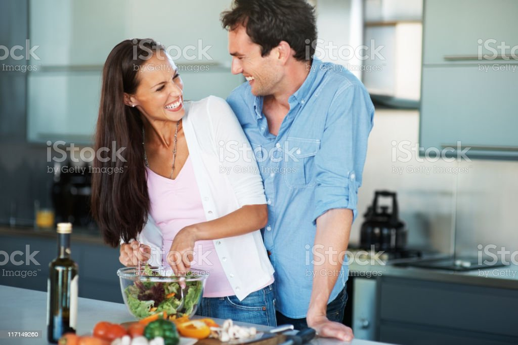 Couple having fun in the kitchen royalty-free stock photo