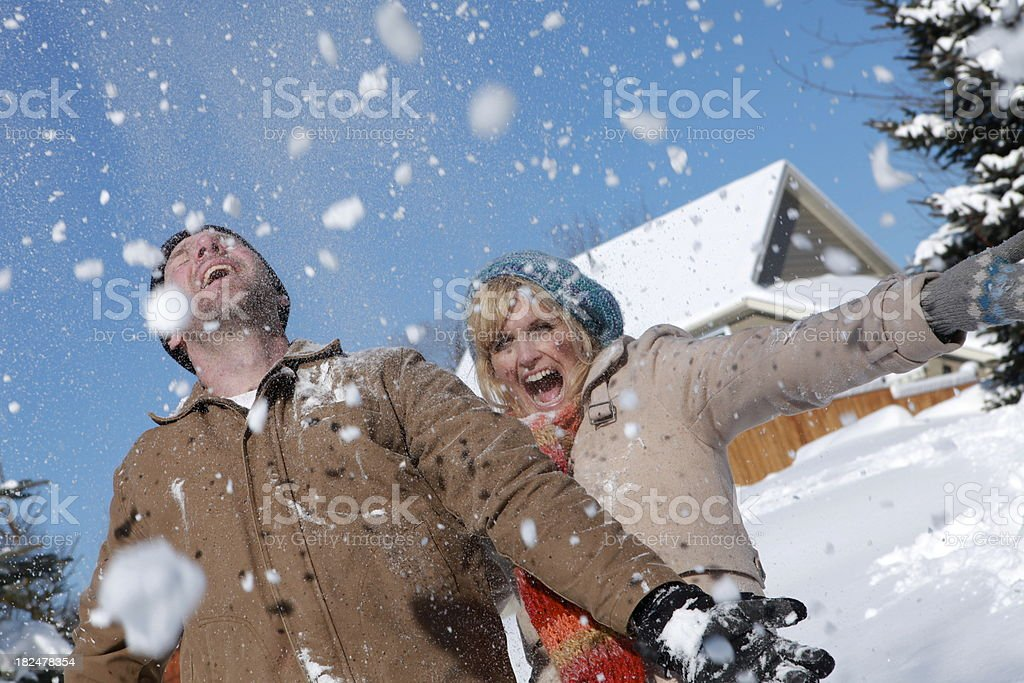 Couple Having Fun in the Snow royalty-free stock photo