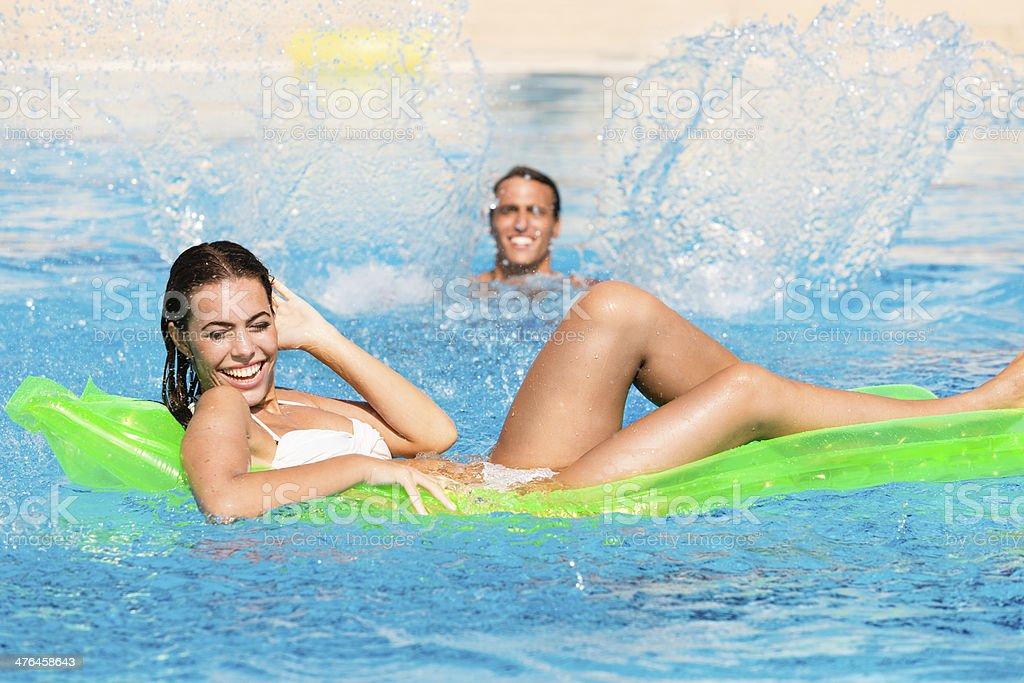 Couple having fun in the swimming pool royalty-free stock photo