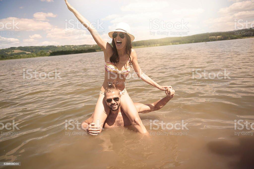 Couple having fun in the water stock photo