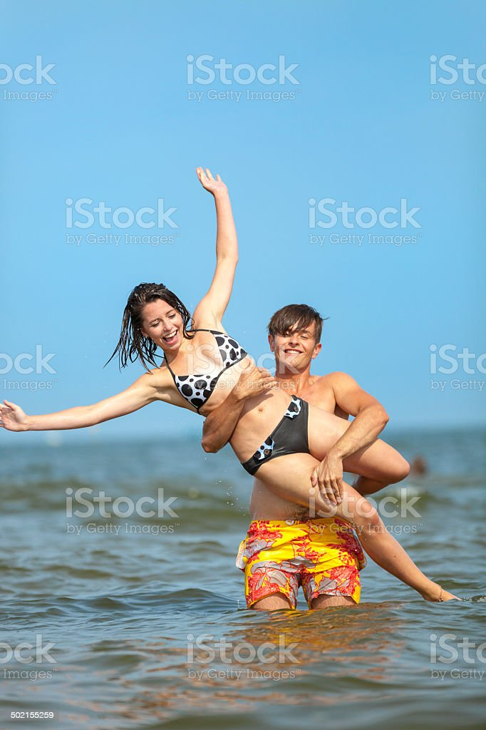 Couple Having Fun In Water royalty-free stock photo