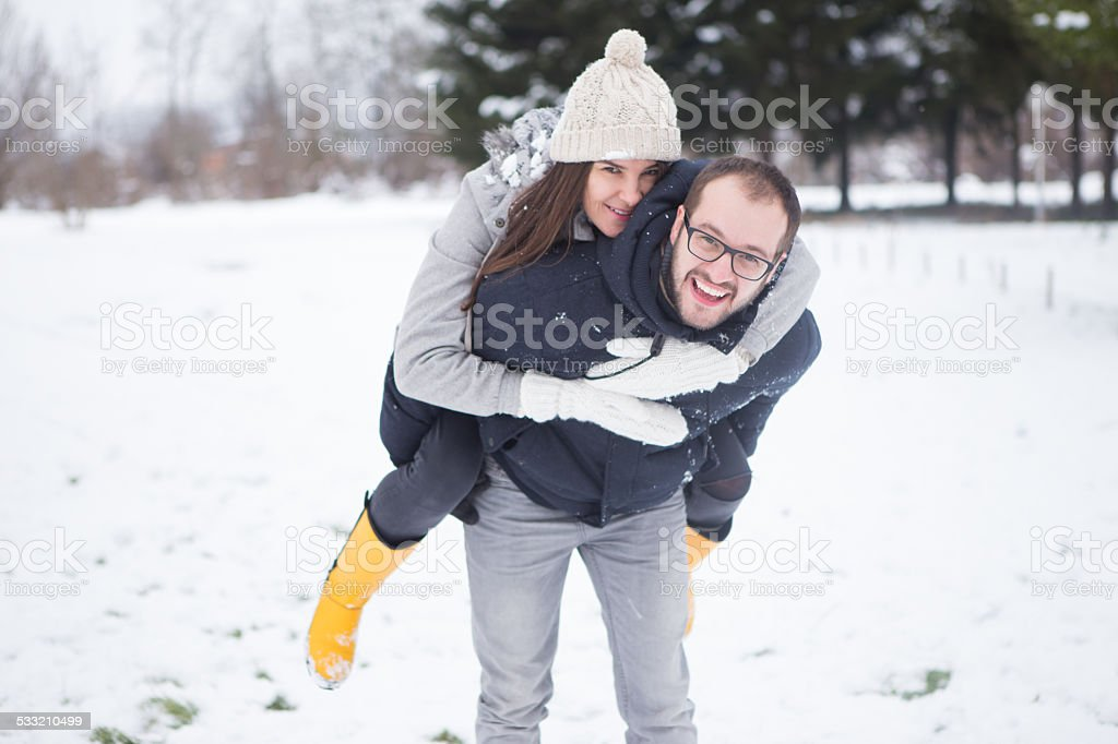 Couple having fun on snow stock photo
