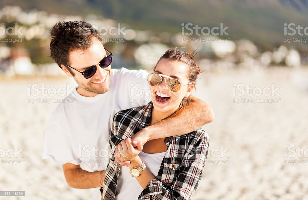 Couple having fun on the beach royalty-free stock photo