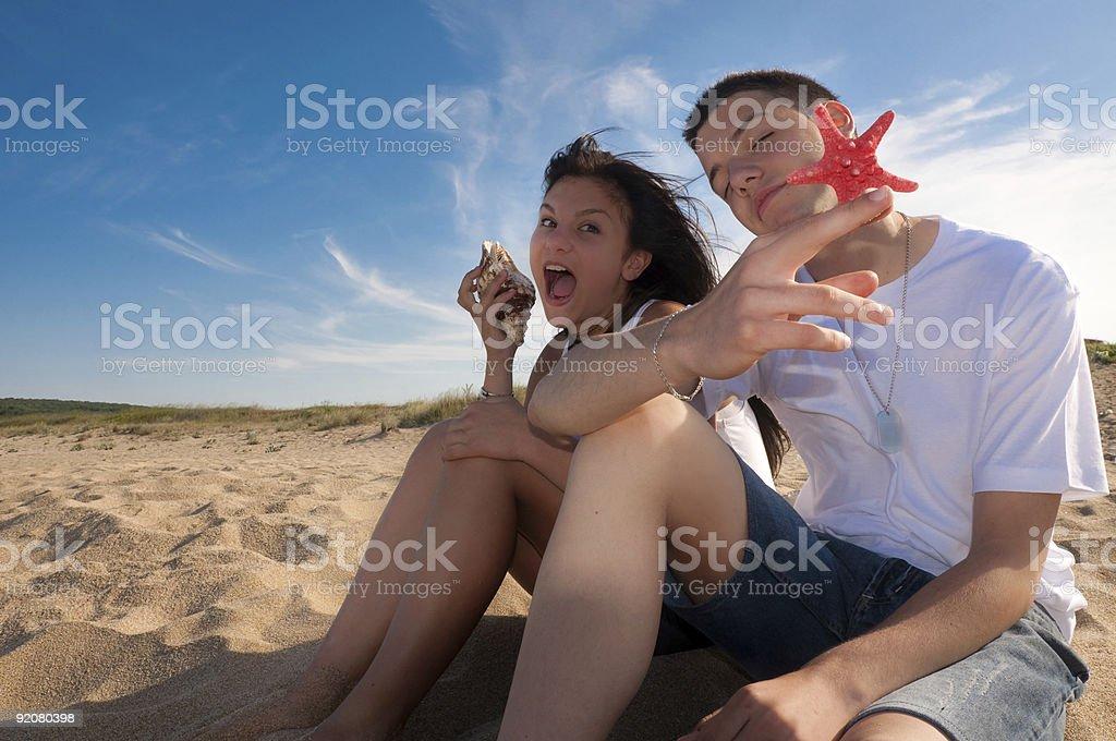 Couple having fun on the beach royalty-free stock photo