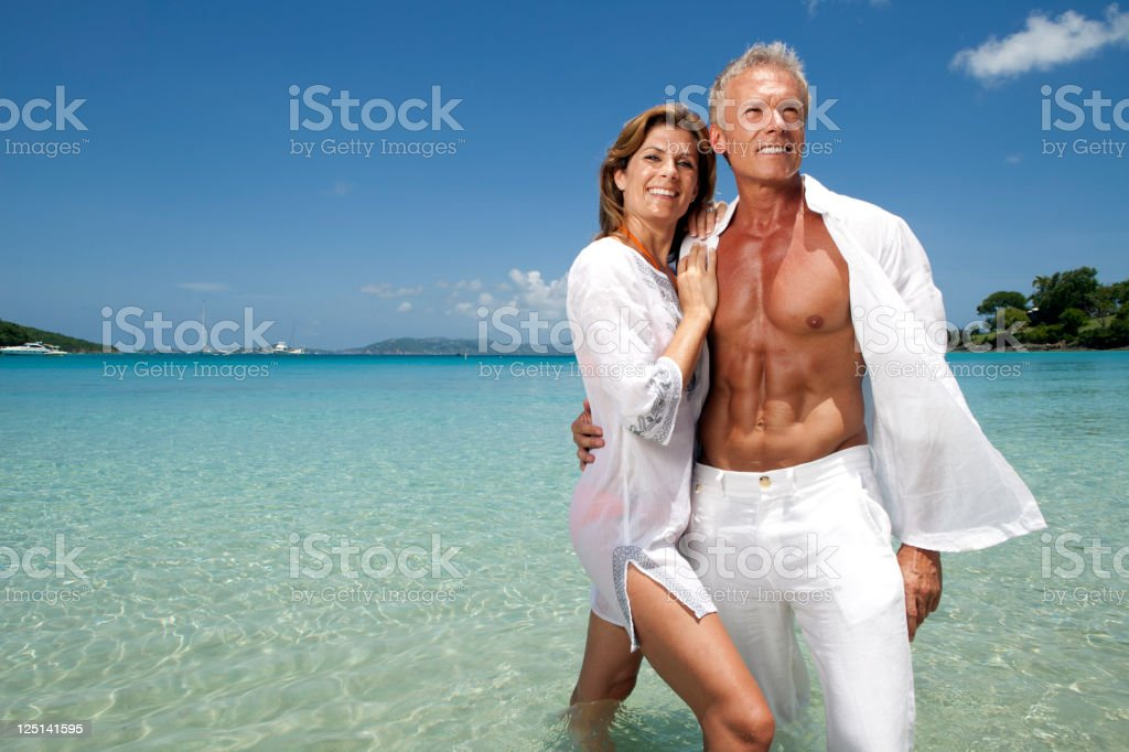 Couple having fun on tropical vacation stock photo