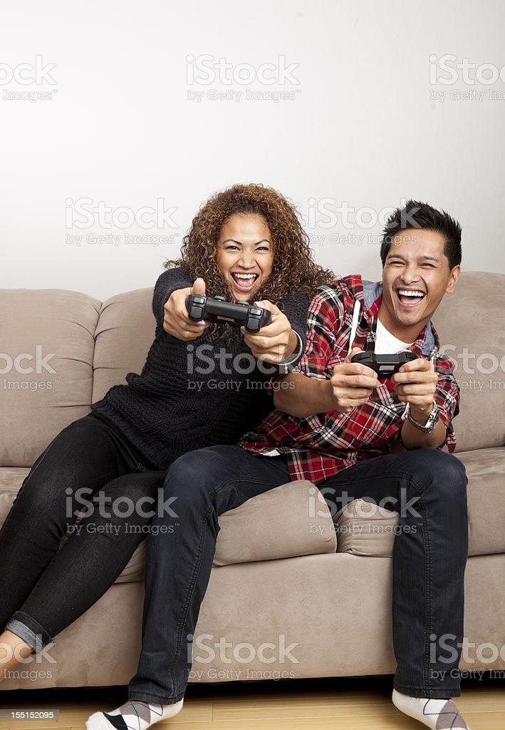 couple having fun playing video game stock photo