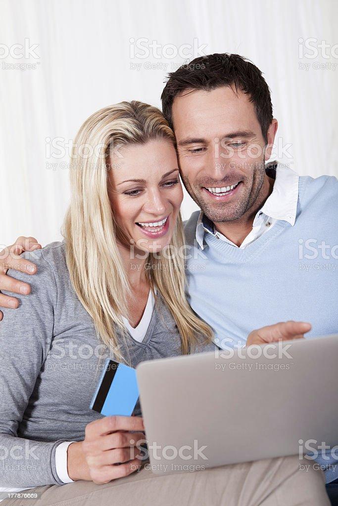 Couple having fun shopping online royalty-free stock photo