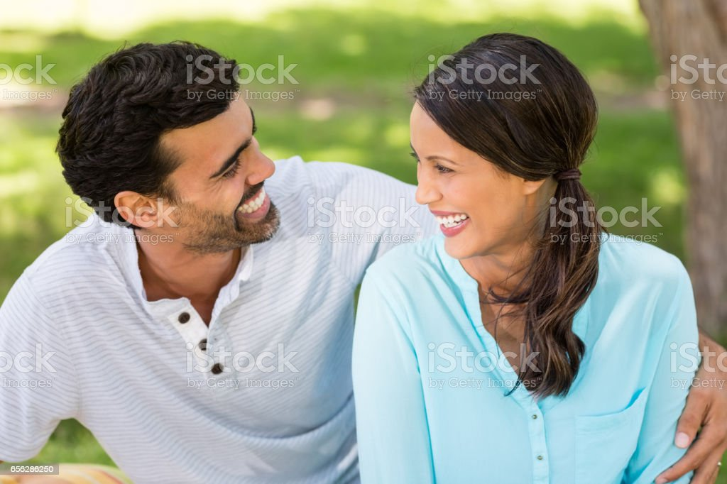 Couple having fun together in park stock photo
