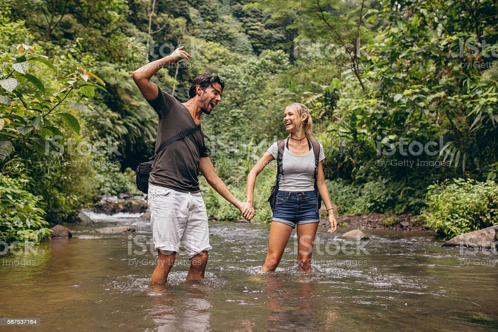 Couple having fun together outdoors on a hike stock photo