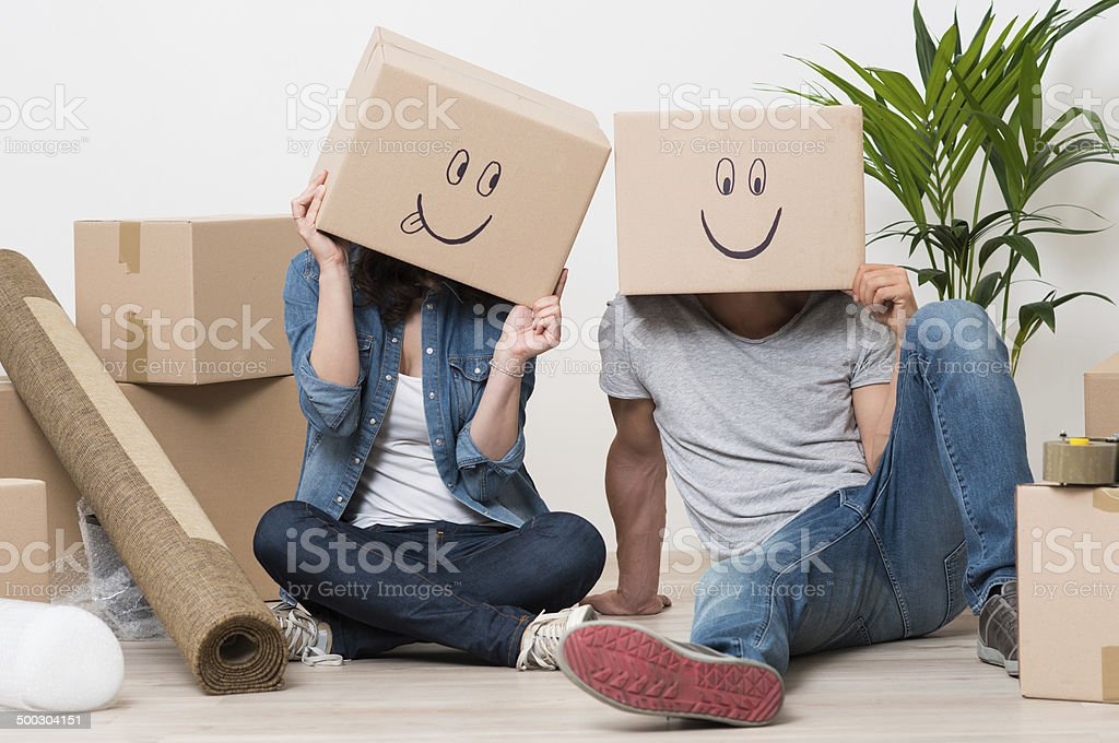 Couple having fun while moving home stock photo