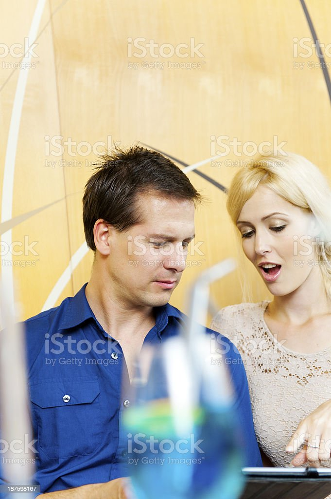 Couple having fun with digital tablet royalty-free stock photo