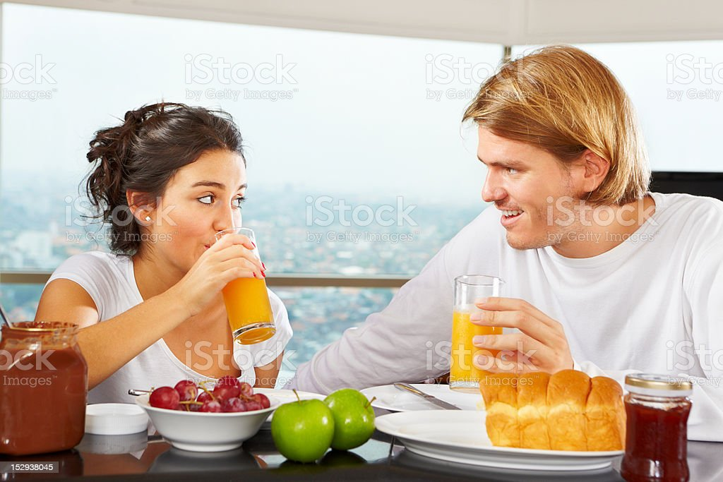 Couple having great time on breakfast royalty-free stock photo