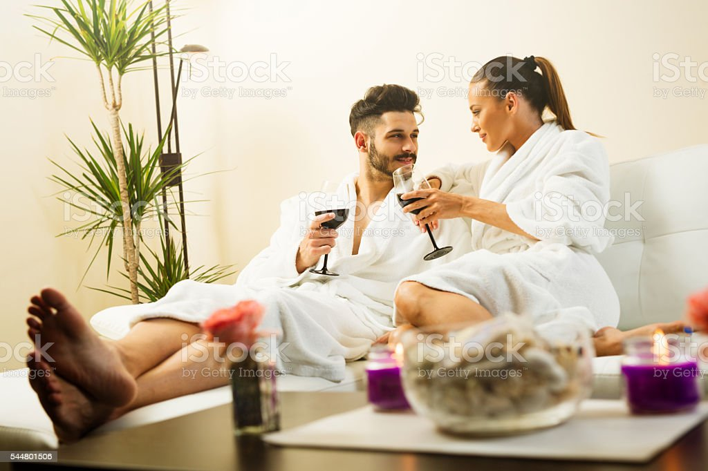 Couple having great time together at spa. Wine toasting. stock photo