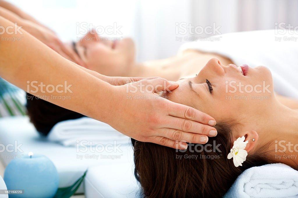 Couple Having Head Massage At Spa Center royalty-free stock photo