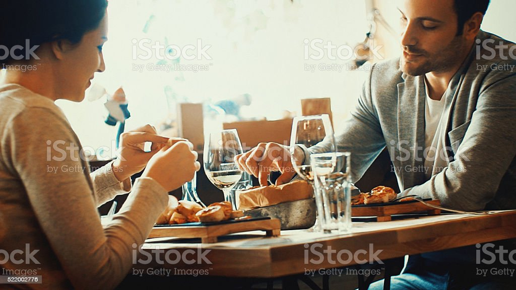 Couple having lunch in a restaurant. stock photo