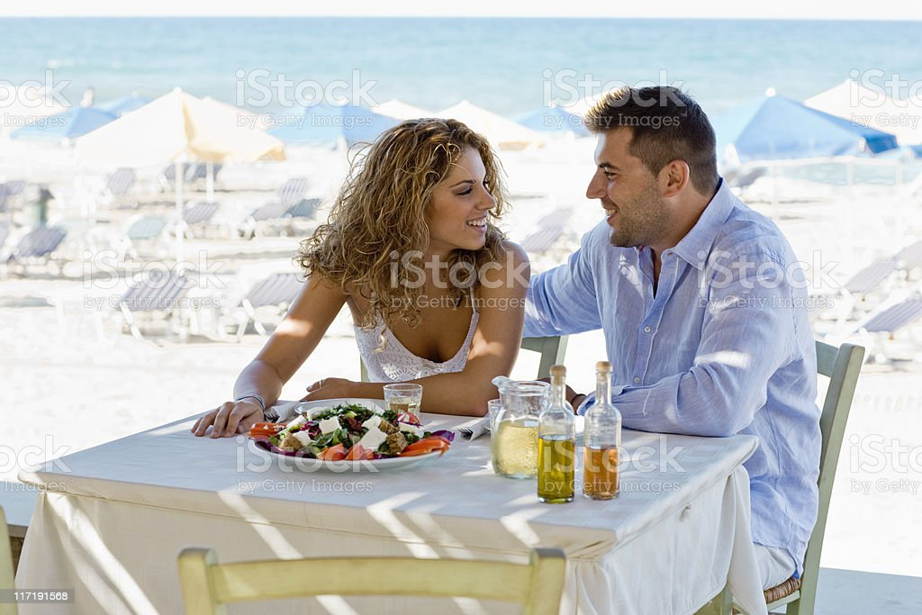 couple having lunch near the beach stock photo