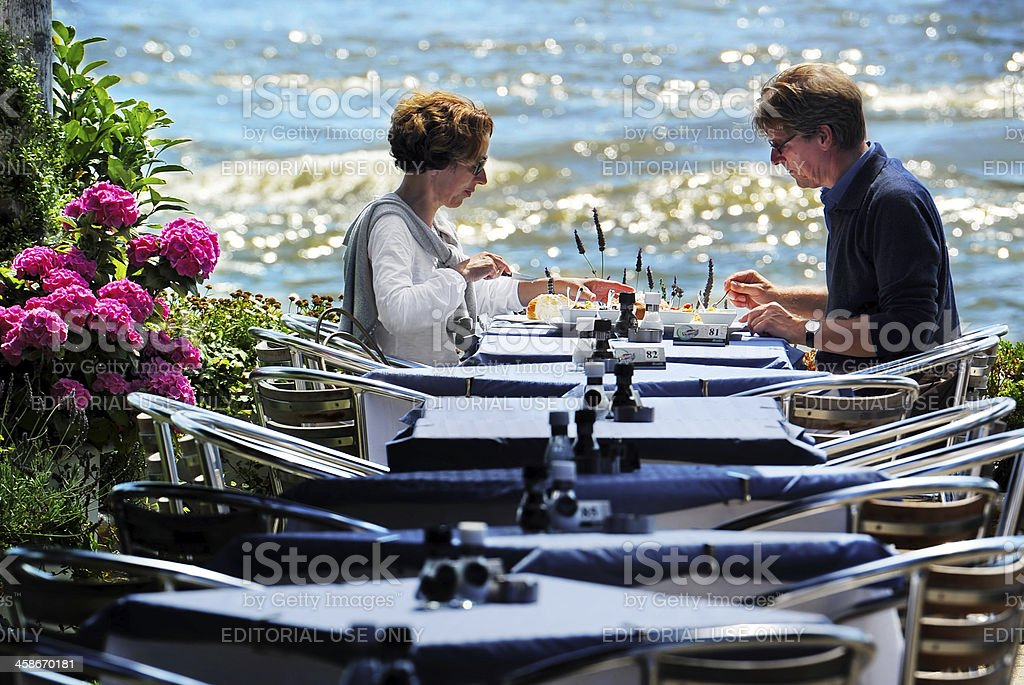 Couple having lunch on sunny terace royalty-free stock photo