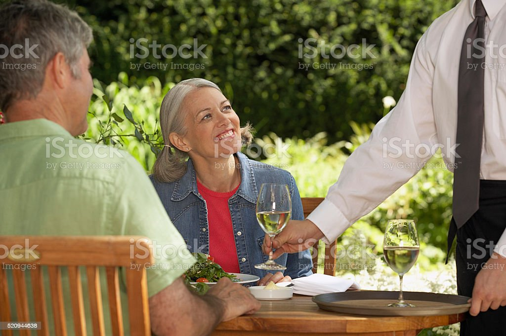 Couple having lunch outdoors stock photo