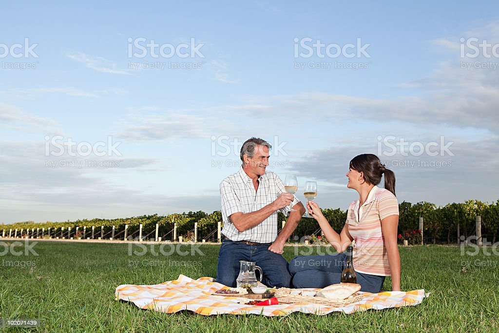 Couple having picnic in vineyard royalty-free stock photo