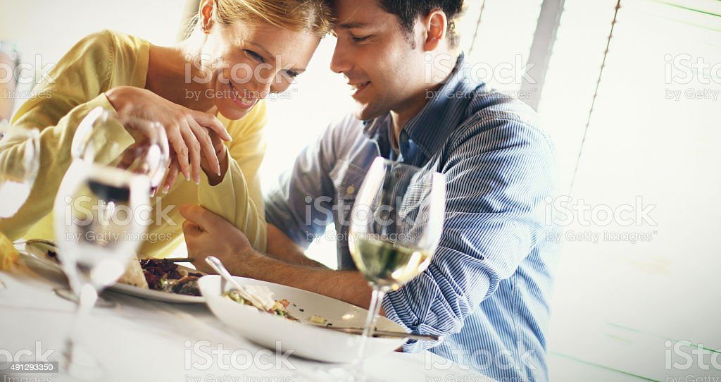Couple having romantic dinner. stock photo
