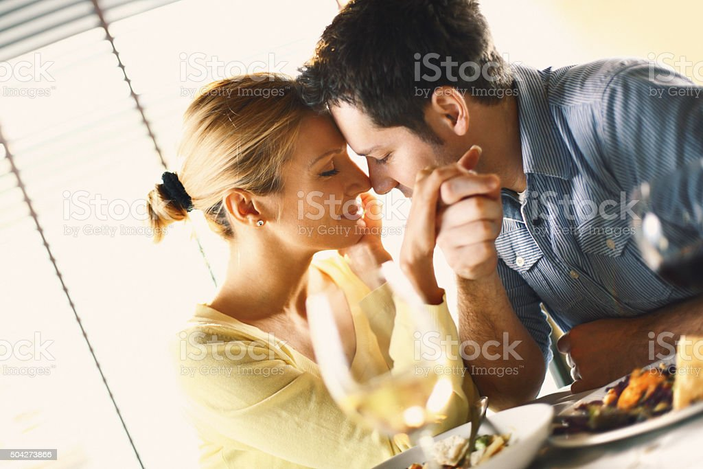 Couple having romantic meal at a restaurant. stock photo