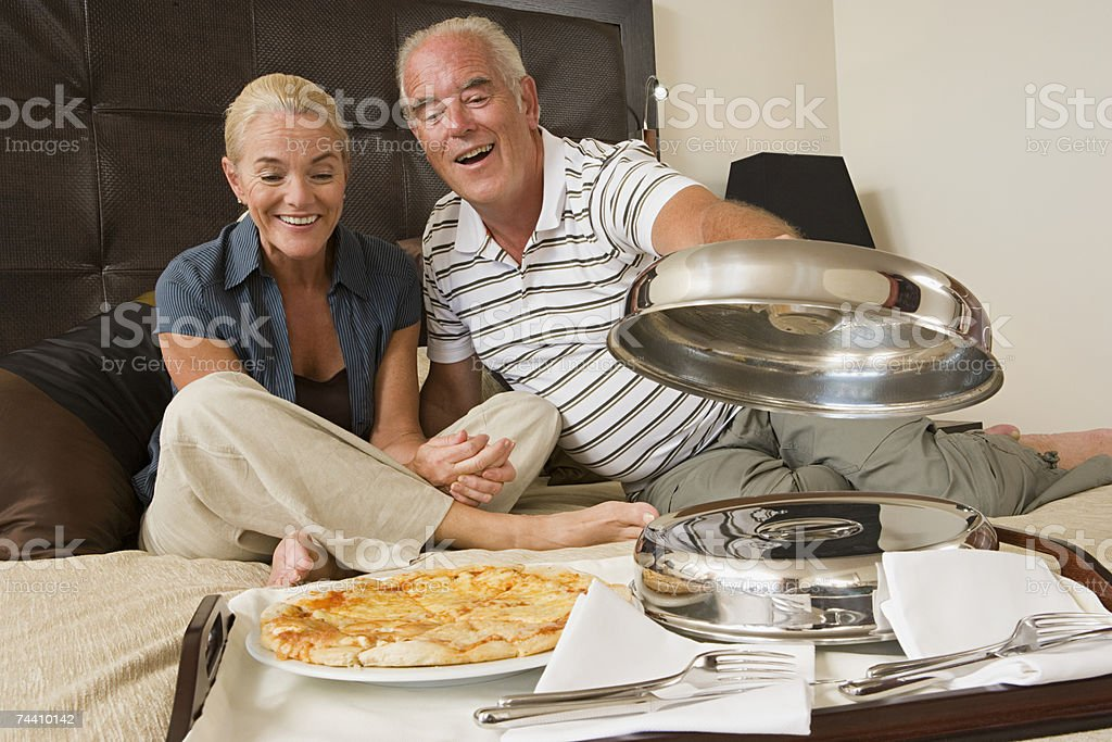Couple having room service stock photo