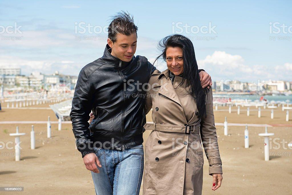 Couple having seaside fun in winter stock photo