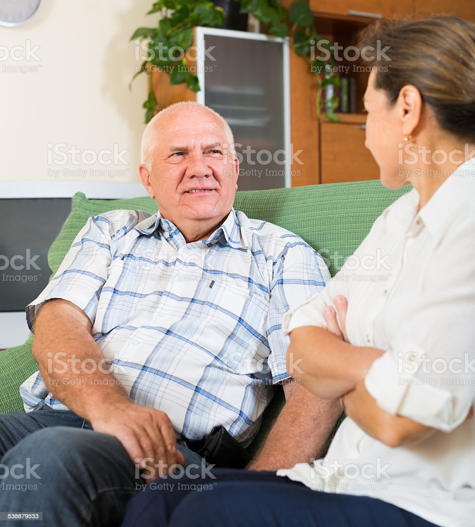 couple having serious talking in home stock photo